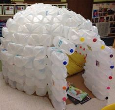 What a good idea for the kids to make use of all the plastic milk jugs we buy! This milk jug igloo is another kind of fort the little ones will enjoy. :) This recycling idea is commonly done as a s… Milk Jug Projects, Diy Projects, Recycling Projects, Milk Jug Igloo, Igloo Craft, Plastic Milk Bottles, Water Bottles, Plastic Containers, Milk Carton Crafts