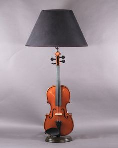 This quirky violin table lamp will make a talking point in any room whilst remaining perfectly in tune with your lighting needs....