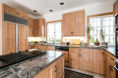 Kitchen, Marble Counter, Cooktops, Wood Cabinet, Wall Oven, Refrigerator, Drop In Sink, Dishwasher, Rug Floor, and Recessed Lighting On the main floor, the kitchen is connected to a private bedroom and bathroom, making this an ideal space for guest quarters.