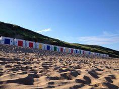 Beautiful beach huts on the beach at Woolacombe,North Devon.