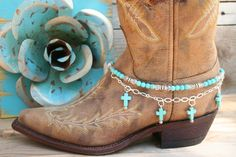 Boot Candytm is the best thing to happen to your boots since you broke them in... This item contains Natural Howlite, dyed Turquoise beads and sparkling clear Czech crystals. The accent silver plated chain holds 4 Natural Howlite, dyed Turquoise Cross charms. Adjustable to fit your cowboy boots, your fashion boots and your winter boots, too!