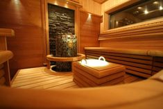 I love the look and layout of this sauna, and the stone wall feature is great, but I would really like it to be wood burning and not electric