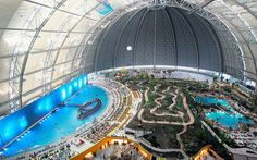 If you're looking for the biggest water park in the world, Germany likely doesn't come to mind.But 30 miles south of Berlin, inside a former airship hangar, which is frosted in snow in the winter,...
