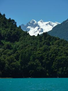 Todos los Santos Lake, Puerto Varas, Chile — by Erin.... A glimpse of Tronador from Todos los Santos lake in Chile. This mountain is on the border between Chile and Argentina.
