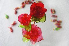 Step by step description of how to make a unique rose by hand out of heated Jolly Rancher hard candies.