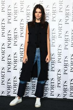 Kendall Jenner wearing Ports 1961 White Leather Bow Sneakers, Ports 1961 Fall 2015 Vest and Ports 1961 Colorblock Denim Jeans