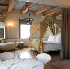 iise crawford soho house nyc bedroom, white brick, saarinen table