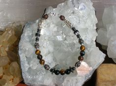 A personal favorite from my Etsy shop https://www.etsy.com/listing/226867779/tigers-eye-and-hematite-beaded-gemstone
