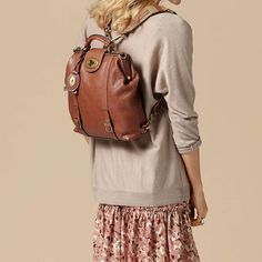 I love this Fossil backpack purse! Perfect for biking. Straps convert to a crossbody.