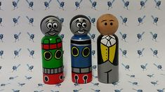 Hand Painted Wooden Peg Dolls - Thomas the Tank & Friends Characters currently available - Thomas, Percy & The Controller (any other character can be requested, please message me). Peg dolls stand at approximately 9cm, each peg is hand painted with non toxic acrylic paint, includes
