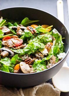 Mushroom spinach salad with tomatoes, sautéed mushrooms, honey pecans, goat cheese and mushroom vinaigrette.