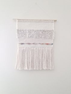 Textured hand woven wall hanging measures 10 inches x 13.5 inches. wooden dowel measures 12 inches  A mix of Hand dyed wool, alpaca, silk, bamboo,