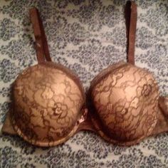 NWOT Adrienne Vittadini 38C Bra Only tried on, never worn. Lightly lined. Adjustable straps. Beautiful details. Color accurate in 2nd photo. Would fit a 36 also Adrienne Vittadini Intimates & Sleepwear Bras