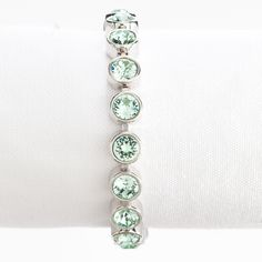 """<p>Ice Bracelet featuring a continuous row of sparkling Chrysolite crystal with a single foldover clasp; 7 ¼"""" length. Rhodium plating.</p>"""