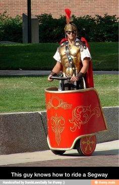 The only way to ride a Segway. Rory style.<<<<<Rory got a segway!