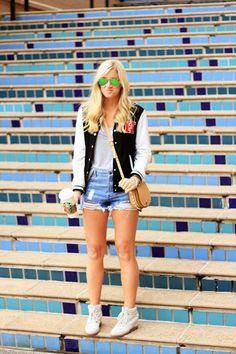 jean shorts and varsity jacket