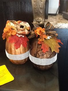 We took copper painted pumpkins and covered them with black printed panty hose, added leaves and bows and rhinestones......and ta da, instant decoration for fall!  You can see it at the The Marmalade Tree!
