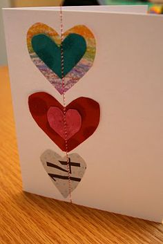 Easy, cute handmade cards. have the kids cut out hearts from assorted papers and one zip through the handy-dandy sewing machine and viola!