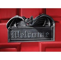 Vampire Bat Welcome Wall Sculpture. Guests get a Gothic welcome when our fiery-eyed gothic bat wraps his majestic wings around our 10-inch-long plaque! Our Design Toscano exclusive vampire bat statue is embellished with fearsome skulls, cast in quality designer resin, then made even more macabre with a ghoulish ebony finish for menacing display on home or garden wall. designtoscano.com