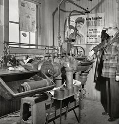 November 1942. Chicago, Illinois. These pneumatic tubes in the Illinois Central Railroad yardmasters office connect him with the general office. Medium-format negative by Jack Delano for the Office of War Information.