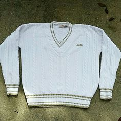 Vintage Ellesse Sweater ??Vintage Ellesse Sweater?? -gold trim  Condition: Great **flaws: two small stains, one on back of sleeve and the other on bottom front(pictured)**  Size: M (fits oversized) Vintage Sweaters