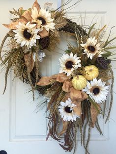 This unique Wreath measures 36 inches in length and 27 inches wide from tip to tip. Designed on a grapevine wreath with ribbons, and all the