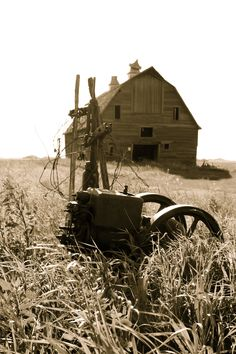 Oh look what I found. A pic of Grandpa's old tractor next to the barn. I think I like these old sepia photos of yester-year.....