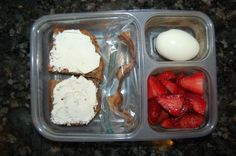 Whole-wheat banana bread topped with cream cheese, hard-boiled egg, leftover strip of local bacon, and local strawberries
