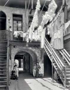 "New Orleans circa 1937. ""1133-1135 Chartres Street."" Laundry day in the Quarter. by Frances Benjamin Johnston."