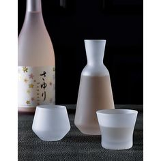 Free Shipping.  Shop 3-piece frosted sake set.   Handmade frosted glass Tokkuri (pitcher) and two uniquely shaped Ochokos (glasses) serve up sake by tradition.  Softly angled designs give each a sculptural appeal.