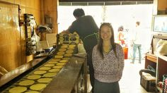 Marisa posing in front of a tortilla factory in La Roma. Casa Jacaranda Cooking class and Market Tour in Mexico City.