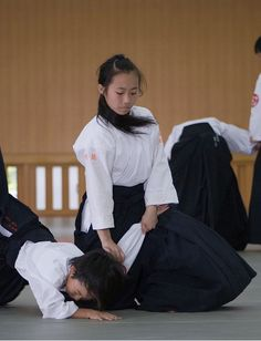 Girl performs an immobilisation--Aikido