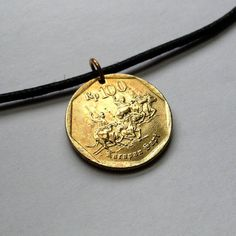 1995 Indonesia 100 Rupiah coin pendant charm by acnyCOINJEWELRY