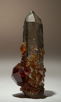 Quartz with Spessartine by usageology on Flickr. Locality: Yunxiau, Funian Province, China Size: Quartz crystal is 1.7 inches tall.