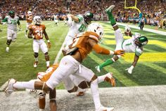 Oregon Ducks wide receiver Josh Huff (1) flies into the end zone in last minute of the second quarter to make the score 20-7 against the Texas Longhorns in the Valero Alamo Bowl