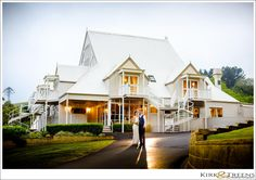 bride and groom out the front of Maleny Manor in the Sunshine Coast Hinterland