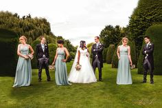 A different take on a bridal party photo. Love those poses by the bridesmaids and groomsmen.