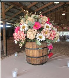 something about a wildflower bouquet in a barrel, I love.