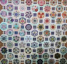 Japanese quilt with elaborate applique, posted at Seams French: Alsace Quilts 2012