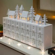 Noma Wooden light-up Christmas advent calendar- at Debenhams.ie
