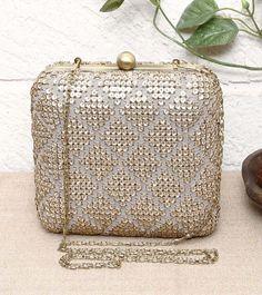 Golden Sequined Metal Clutch=Inayat $ 154