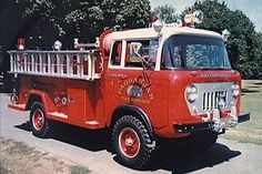 Valley Fire Truck of Bay City, Michigan built a small number of FC conversions. This 1965 example has been restored by Andy Harvey of Pennsylvania, and lettered for his Pagsanjan Fire Brigade. The truck has a 200-gallon booster tank and 200 ft. hose reel. Mechanical features include the Bendix Hydrovac brake booster.    Andy has added some touches of his own which are not original to this truck, including bumper guards on the front, and addi beacon lights visible in a rear view photo (60K…