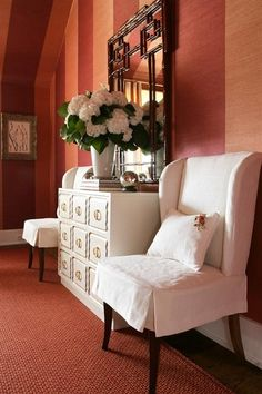 Beautiful entry way - white chairs & dresser, flower bouquet and gorgeous mirror