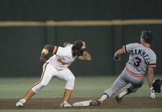 Game 1 or 2 WS - Detroit Tigers shortstop Alan Trammell slides safely into second base with a stolen base as Padres short stop Gary Templeton tries to make the tag. (AP Photo)
