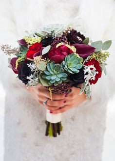 Vibrant shades of crimson and deep plum make this seasonal bouquet a showstopper.