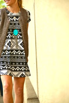 Black and white geometric print dress, brown vest and turquoise necklace.  Fall style!