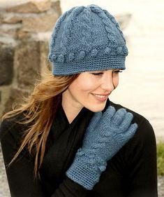 Стильные вязаные шапки для женщин на 2016 год выполняются спицами и крючком