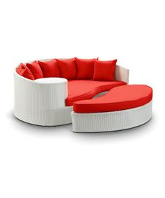 White & Red Taiji Rattan Daybed & Ottoman by Modway on #zulily today!  $1000  Includes daybed, seven throw pillows and ottoman  Daybed: 71'' W x 29'' H x 51'' D  Ottoman: 50'' W x 10'' H x 28'' D  Seats: 10'' high  Backs: 29'' high  Synthetic rattan / aluminum  No assembly required