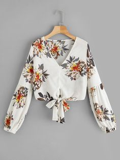 Casual Knot Floral Top Regular Fit V Neck Long Sleeve Bishop Sleeve Pullovers Beige Crop Length Floral Print Knot Hem Blouse See other ideas and pictures from the category menu…. Faneks healthy and active life ideas Hijab Fashion, Teen Fashion, Fashion News, Fashion Outfits, Spring Shirts, Summer Blouses, Blouse Styles, Blouse Designs, Moda Rock