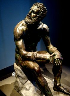 The bronze Boxer of Quirinal or Terme Boxer ,a Hellenistic Greek sculpture dated around 330 B.C. The National Museum of Rome.Discovered on the slopes of the Quirinal possibly from the remains of the Baths of Constantine.A masterpiece of Hellenistic athletic professionalism, with a top-heavy over-muscled torso and scarred face, cauliflower ears, broken nose, and a mouth suggesting broken teeth.